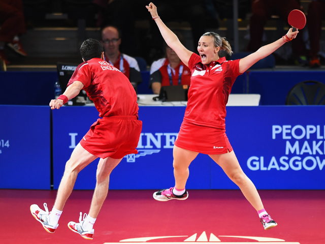 GLASGOW, SCOTLAND - AUGUST 02:  Kelly Sibley and Danny Reed of England celebrate winning the bronze medal following their Mixed Doubles Bronze Medal Match against Jian Zhan and Tianwei Feng of Singapore at Scotstoun Sports Campus during day ten of the Glasgow 2014 Commonwealth Games on August 2, 2014 in Glasgow, Scotland.  (Photo by Jeff J Mitchell/Getty Images)